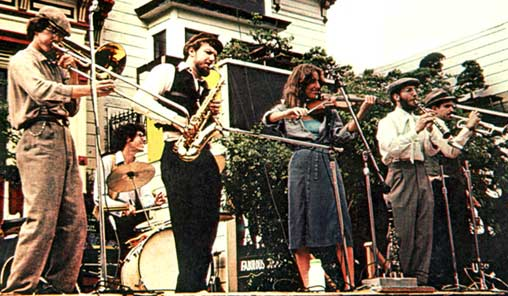 THE KLEZMORIM, San Francisco, 1978. L to R: Rick Elmore, John Raskin, Lev Liberman, Miriam Dvorin, David Julian Gray, Brian Wishnefsky. Not pictured: Suzy Rothfield. [Photo: Chris Strachwitz]